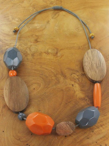 Mixed shape grey and orange resin and wood necklace
