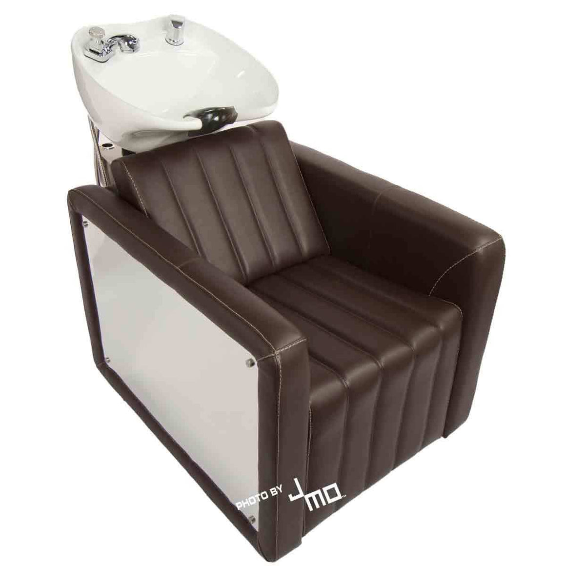 Shampoo backwash hair washing unit with cocoa vinyl, reflective chrome arms, and a white ceramic bowl. Built to be both appealing to the eye and sturdy, this shampoo chair is sure to meet the needs of any salon stylist.