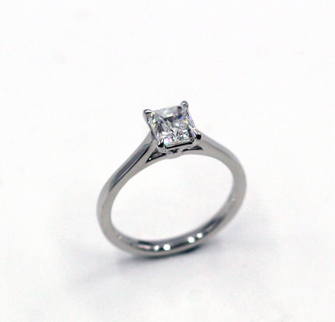 Three Princess Cut Diamond Ring, Center Diamond 1.37 cts.