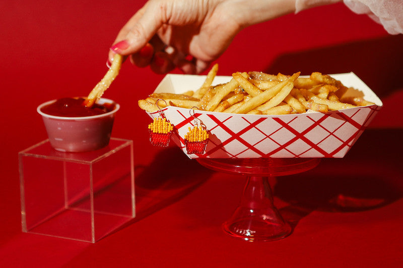 dipping fries into ketchup with pizza beaded earrings