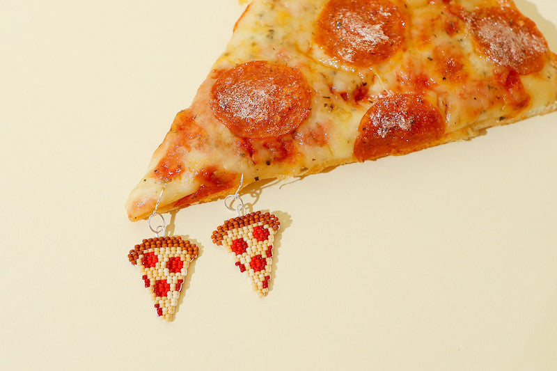 Pizza earrings made of beads next to Haggen pizza