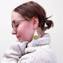Load image into Gallery viewer, Bold beaded earrings in olive green on a woman with glasses