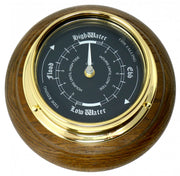 Handmade Prestige Tide Clock in Solid Brass With a Jet Black Dial, mounted on a solid English Oak Wall Mount