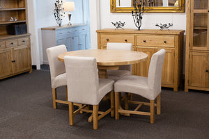 Extending Oval Dining Table with 4 Beige Dining Chairs