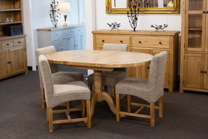 Extending Oval Dining Table with 4 Gold Leaf Dining Chairs