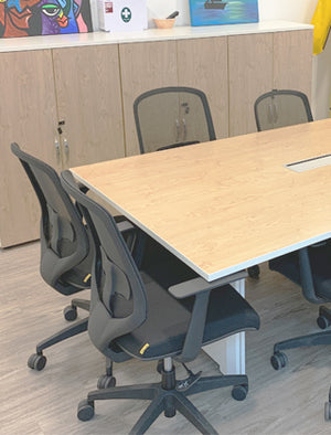 Office chairs and conference table in meeting room