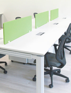 White office workstations with green dividers