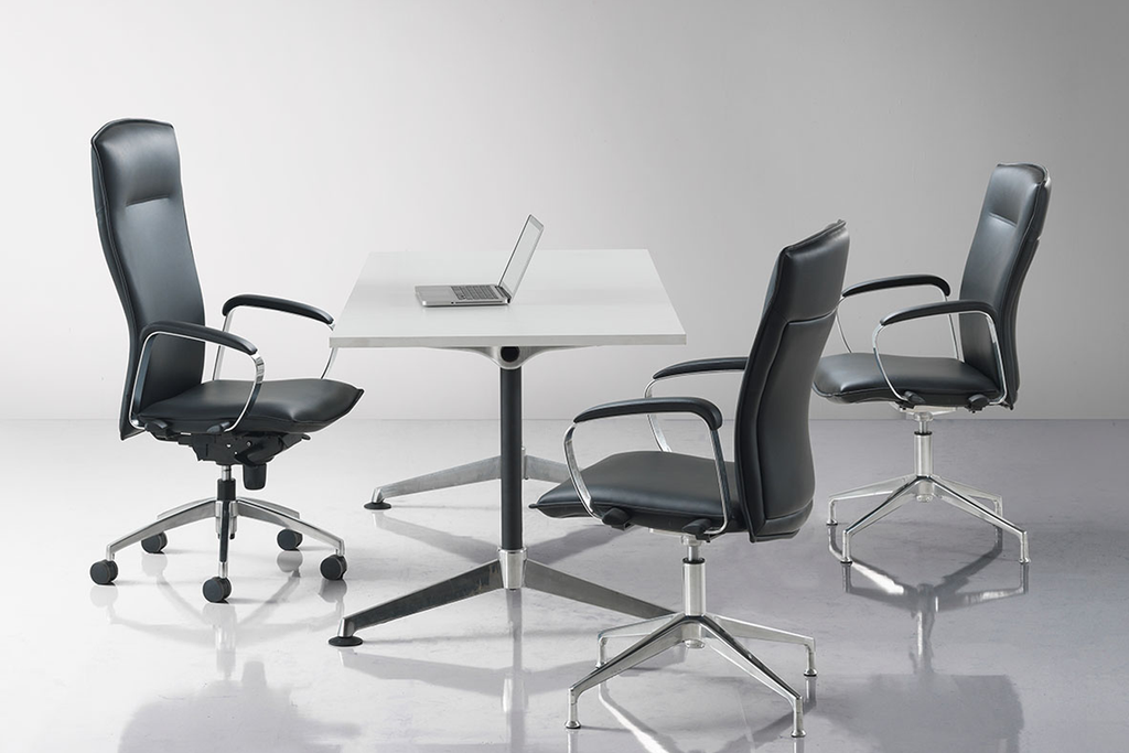 3 Hugo Office Executive Leather Chairs  Around Y2 Foldable Discussion Table in an Office Meeting Room