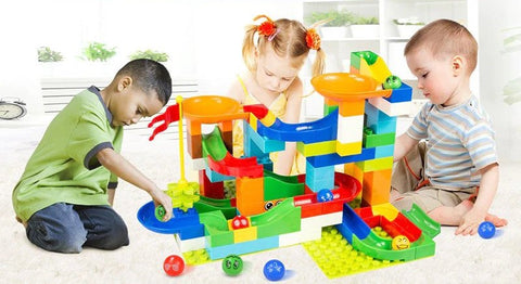 Kids and Toddler Playing Marble Run Race Building Blocks