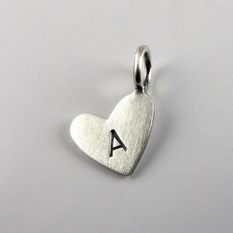 Tiny silver heart with initial pendant