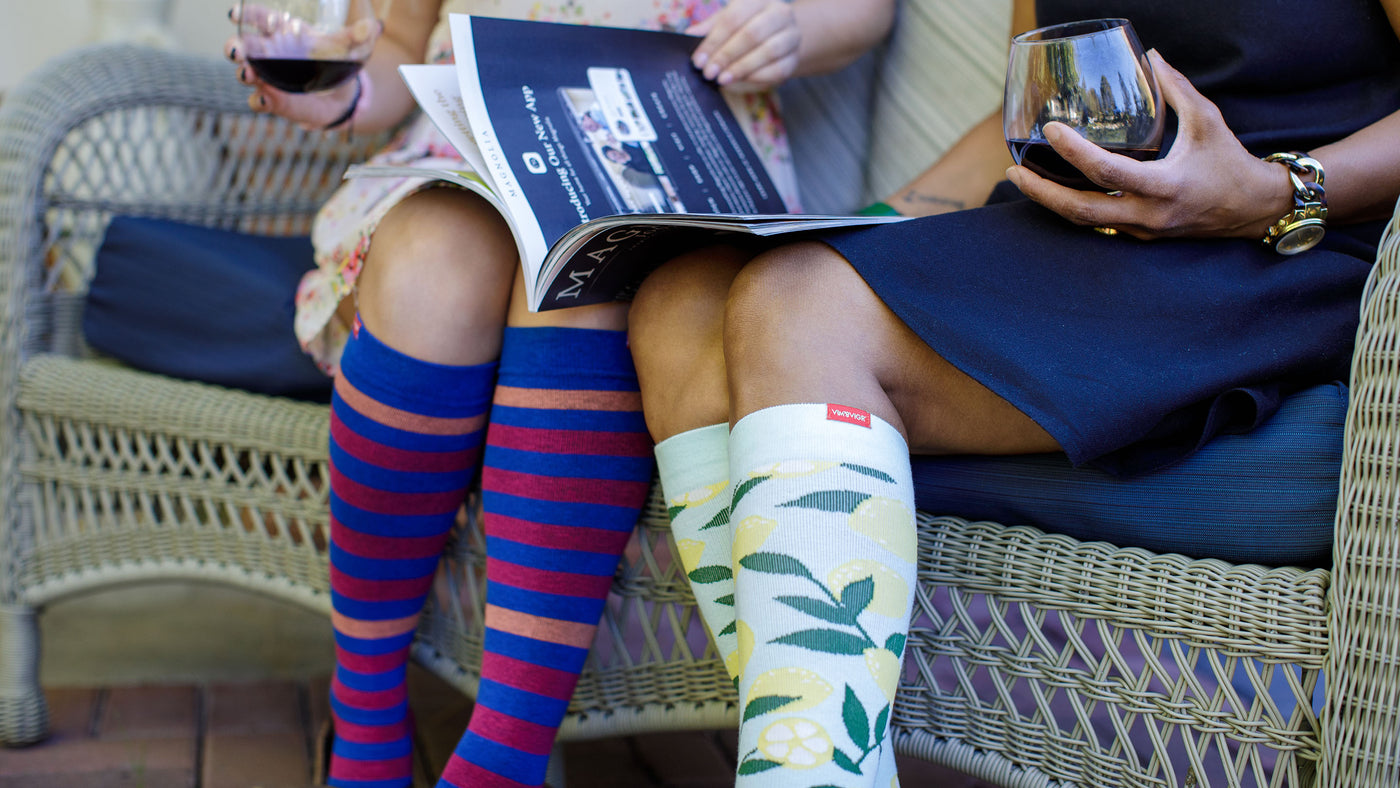 2 women standing with compression socks