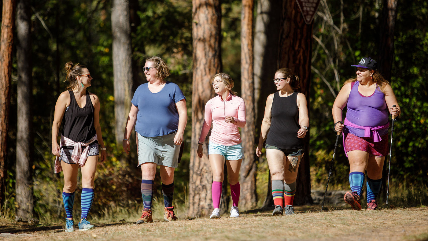 plus size woman with a luggage bag wearing compression socks
