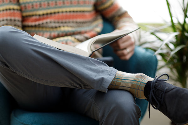 Man reading in compression socks