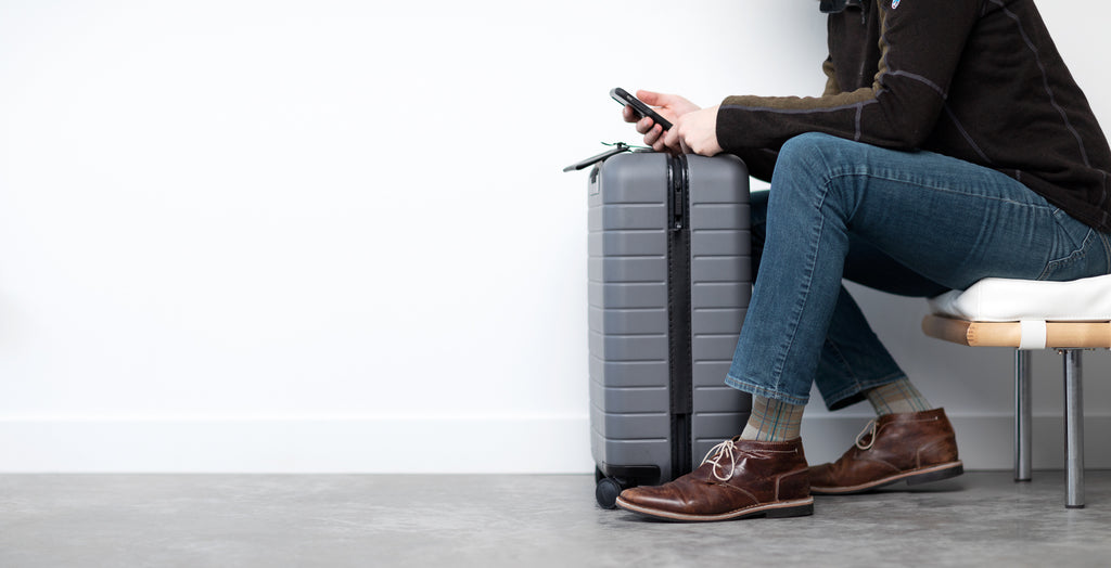 Man traveling with luggage and compression socks