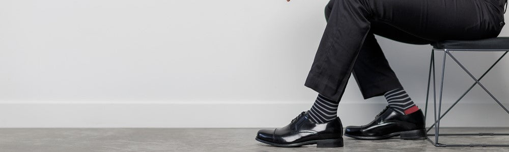 Business professional wearing compression socks