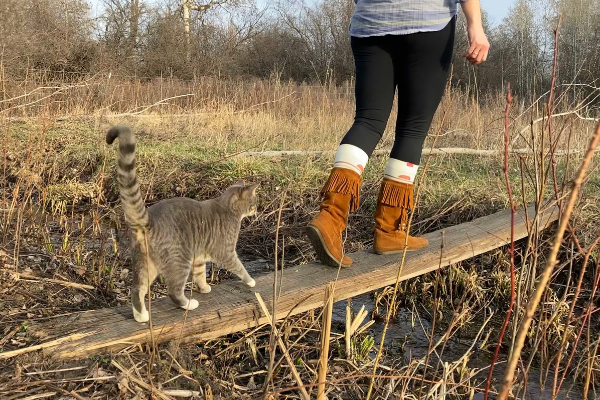 Maura on a walk with her cat.