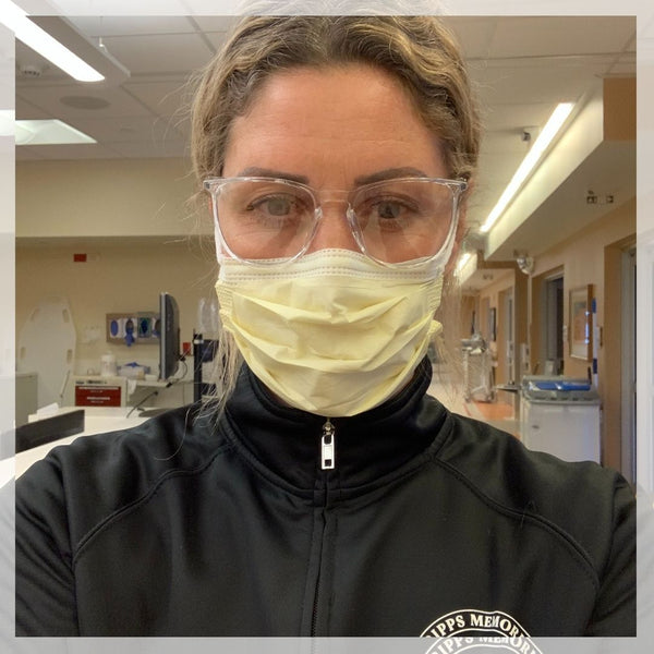 Nurse wearing mask and glasses