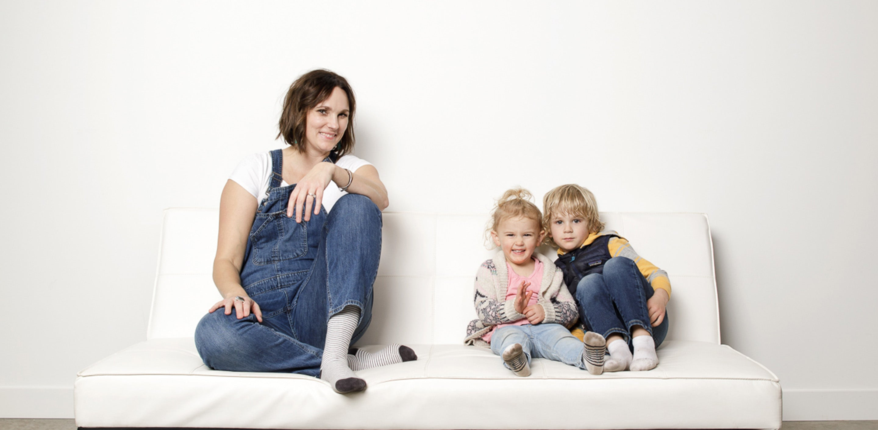 Woman wearing compression socks and sitting next to her kids
