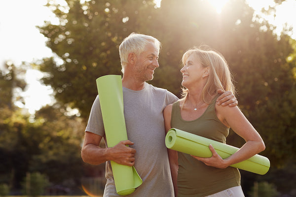 Couple walking with yoga mat