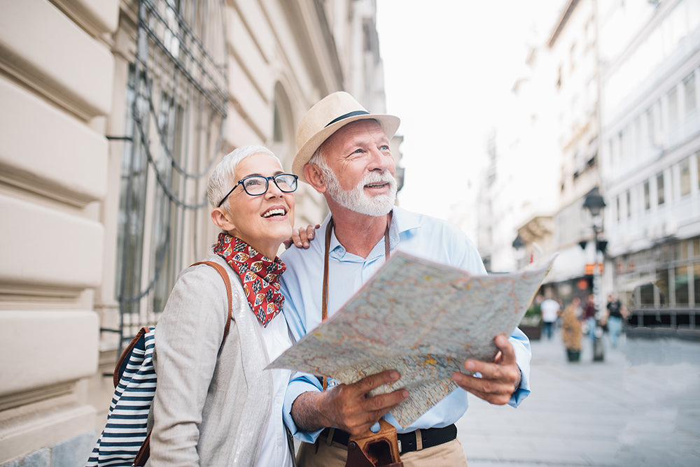 Couple in the city looks at a map