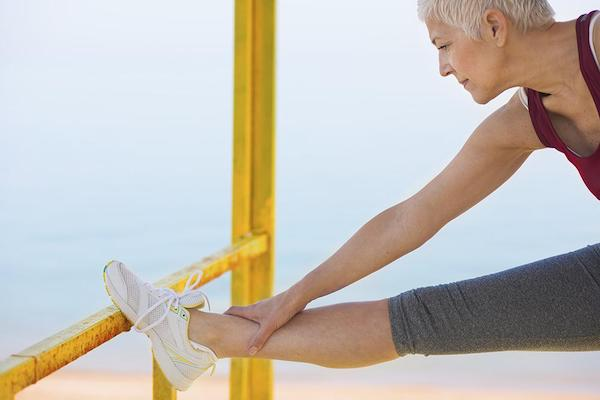 woman stretching tired and heavy legs