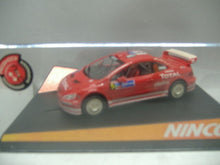 "Laden Sie das Bild in den Galerie-Viewer, NINCO 50351 ""Peugeot 307 WRC Mexico 84`""  Slotcar 1:32  NEU & OVP"