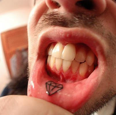 diamond inner lip tattoo