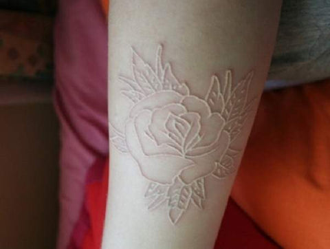 rose white ink tattoo