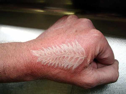fern leaf white ink tattoo