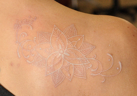 flower white ink tattoo