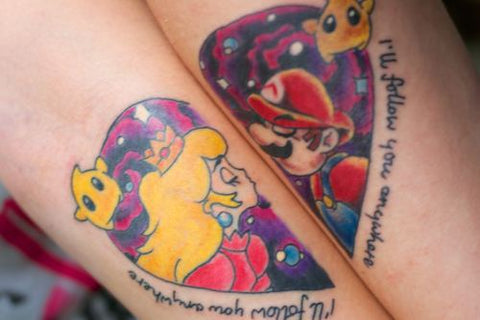 Couple tattoo comic characters heart