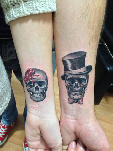Couple tattoos skulls