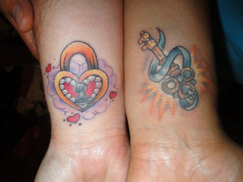 Couple tattoos colour heart & lock