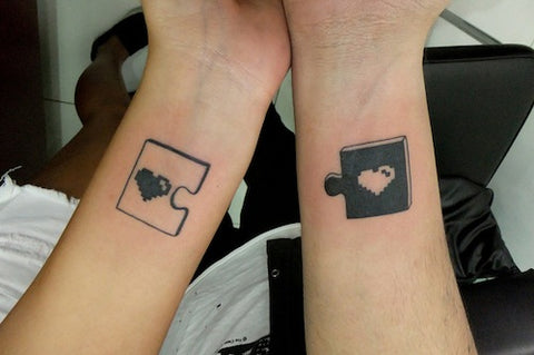 Couple tattoos only 2 puzzle pieces
