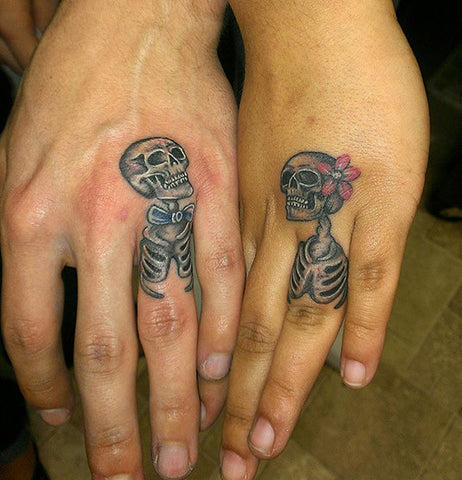 Couple tattoos skeletons