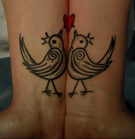 Couple tattoos birds & heart