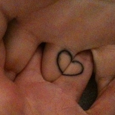 couple tattoo heart