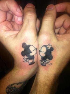 Couple tattoos kissing Mickey & Minnie Mouse