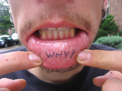 witty inner lip tattoo