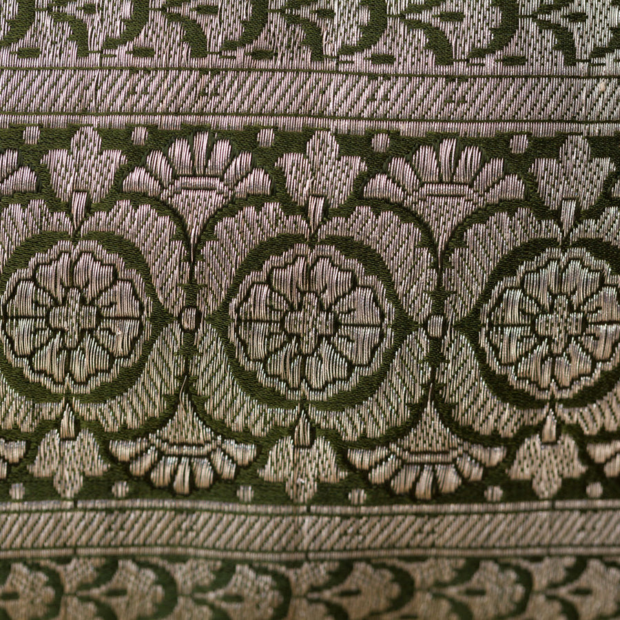 Brocade fabric detail. Metallic thread and khaki green