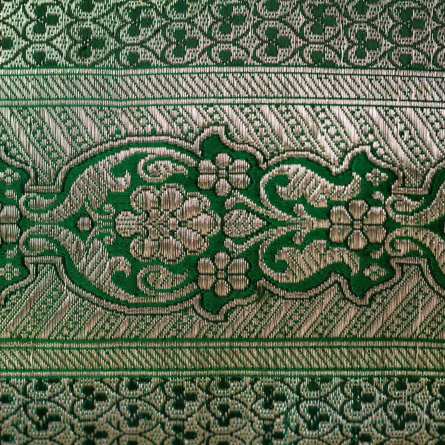 Detail of emerald green weave brocade with metallic thread work. Sustainable accessories handmade in london
