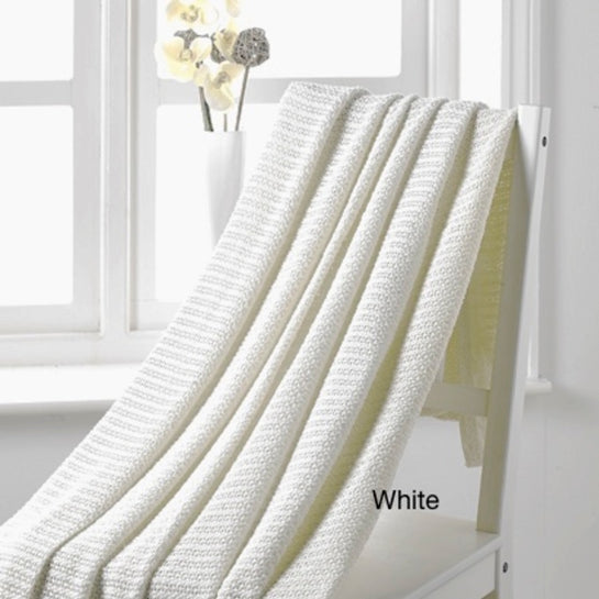 A white Cellular Blanket used for layering bedding to regulate bed temperature from Allergy Best Buys