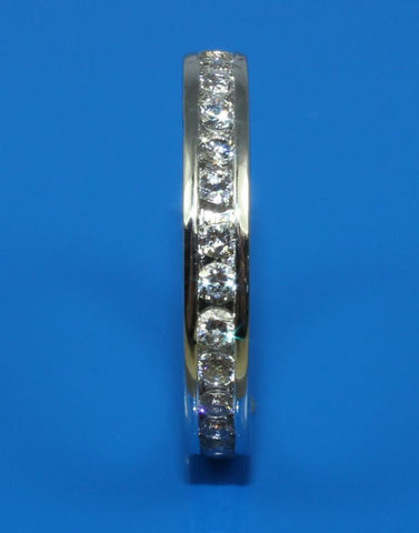 .84ctw Diamond Channel Engraved Band