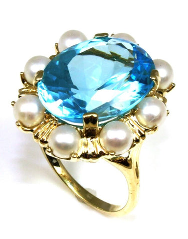 Oval Blue Topaz Ring with a Pearl Halo