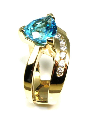 Trillion Blue Topaz Orbit Ring