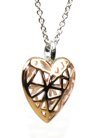 Shiny Caged Heart Necklace by Bastian Inverun