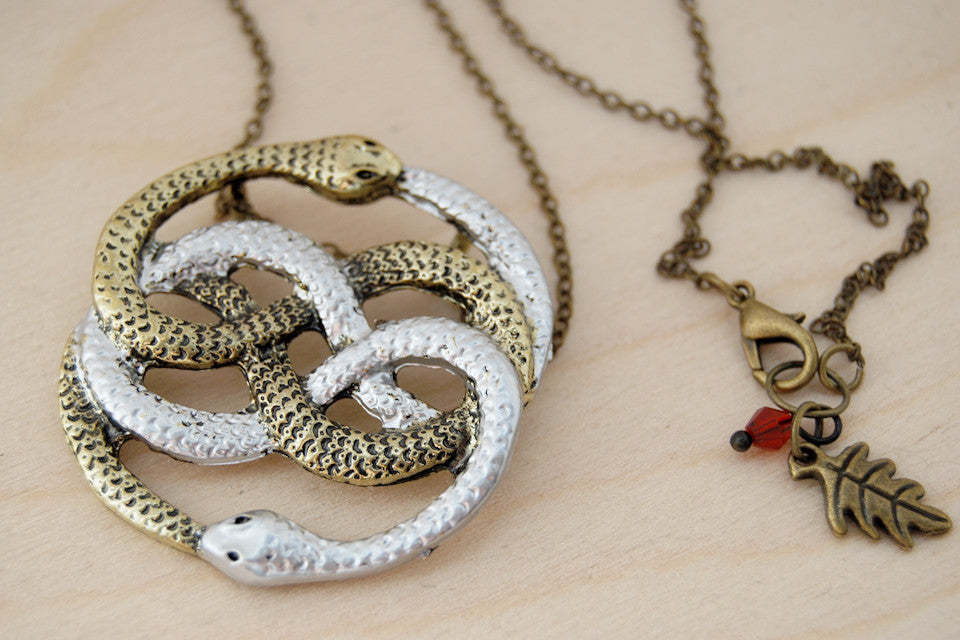 Auryn necklace neverending story necklace 80s fantasy pendant auryn necklace neverending story necklace 80s fantasy pendant enchanted leaves nature jewelry aloadofball Image collections