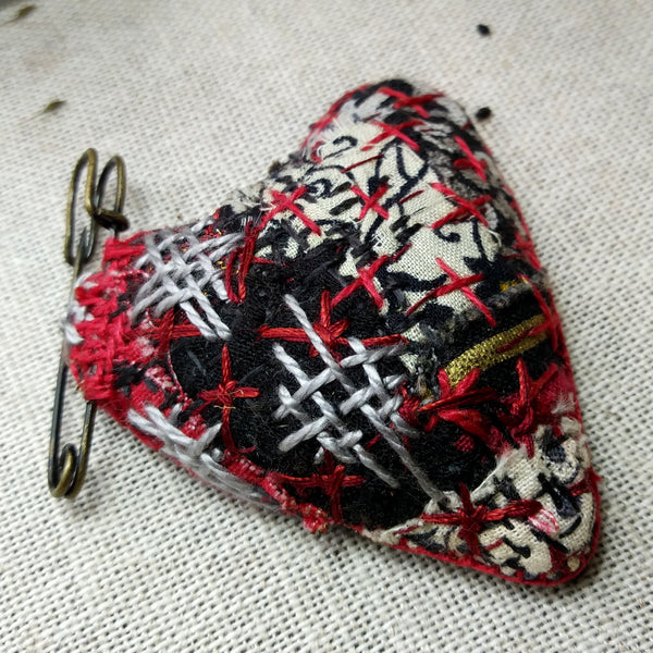 Padded patchwork heart shaped brooch on kilt pin Hand stitched in Boro style. Red and Black.