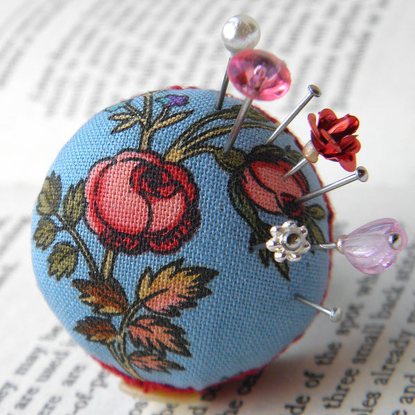 Handmade wearable pincusion ring in blue and red roses design