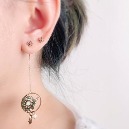 Open Circle with Flower Bead Swing Earrings - White
